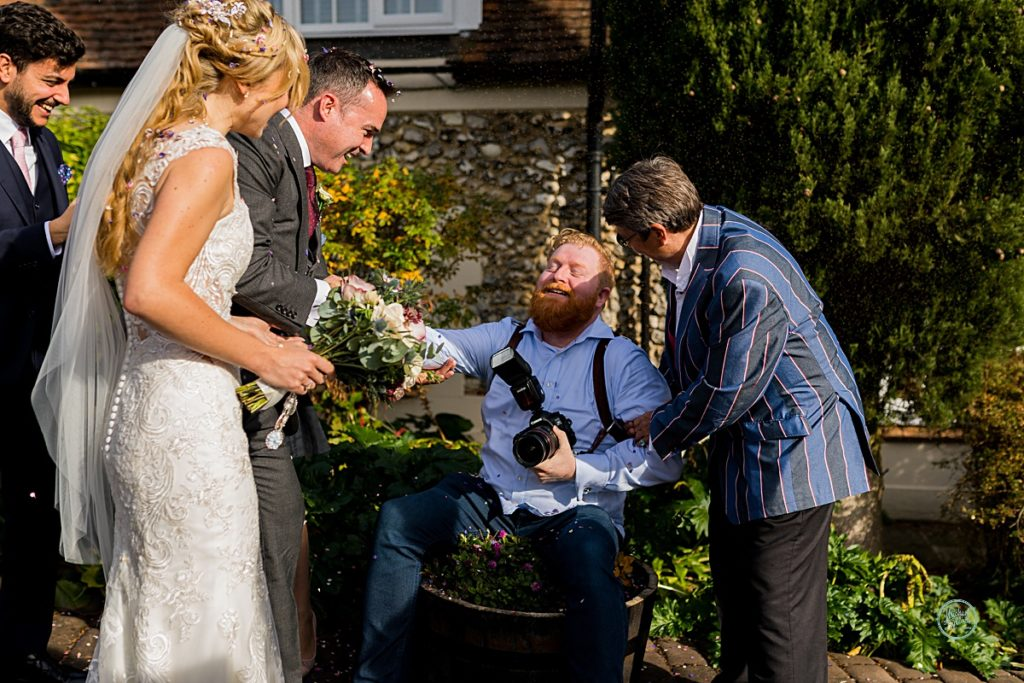 Surrey Wedding Photographer in flower pot, Wedding Photographer Surrey. Fun Wedding Phtogrpapher